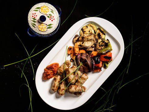 Traditional meatrolls with grilled vegetables photo