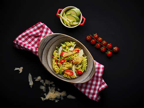 Fusilli with cherry tomatoes photo