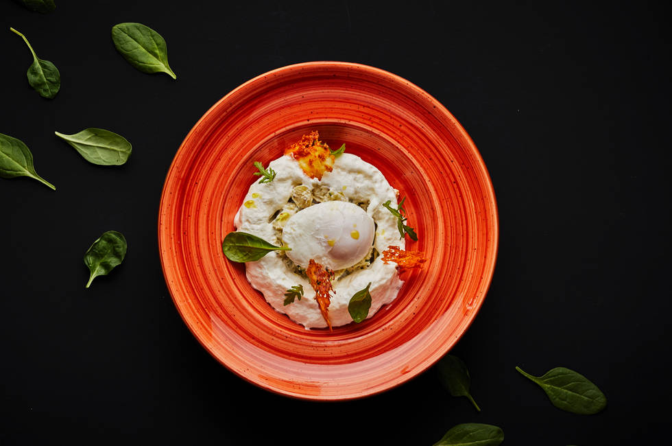 Poached egg with parmesan foam photo
