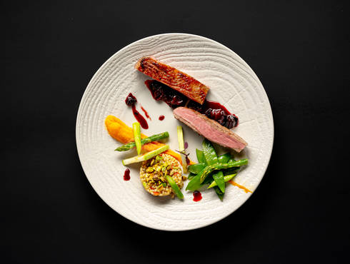 Duck magret with couscous and summer vegetables photo