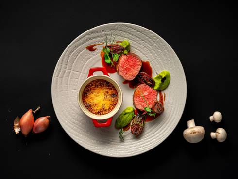 Beef steak with mushroom gratin photo